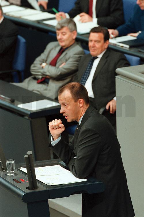 11 MAY 2000, BERLIN/GERMANY:<br /> Friedrich Merz, CDU, CDU/CSU Fraktionsvorsitzender, hält eine Rede; im Hintergrund: Joschka Fischer, B90/Grüne, Bundesaußenminister, und Gerhard Schröder, SPD, Bundeskanzler, Bundestagsdebatte zur Regierungserklärung des Bundeskanzlers zur wirtschaftlichen Situation Deutschlands, Plenum, Deutscher Bundestag<br /> Friedrich Merz, CDU Chairman of the CDU/CSU parliamentary goup, during his speech, in the Background: Joschka Fischer, Green Party, Fed. Minister of Foreign Affairs, and Gerhard Schroeder, SPD, Fed. Chancellor, plenary, German Bundestag<br /> IMAGE: 20000511-01/03-14