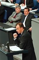 11 MAY 2000, BERLIN/GERMANY:<br /> Friedrich Merz, CDU, CDU/CSU Fraktionsvorsitzender, h&auml;lt eine Rede; im Hintergrund: Joschka Fischer, B90/Gr&uuml;ne, Bundesau&szlig;enminister, und Gerhard Schr&ouml;der, SPD, Bundeskanzler, Bundestagsdebatte zur Regierungserkl&auml;rung des Bundeskanzlers zur wirtschaftlichen Situation Deutschlands, Plenum, Deutscher Bundestag<br /> Friedrich Merz, CDU Chairman of the CDU/CSU parliamentary goup, during his speech, in the Background: Joschka Fischer, Green Party, Fed. Minister of Foreign Affairs, and Gerhard Schroeder, SPD, Fed. Chancellor, plenary, German Bundestag<br /> IMAGE: 20000511-01/03-14
