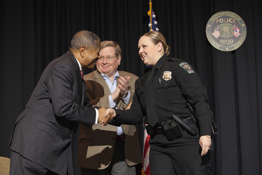 Ohio University President Roderick McDavis shakes hands with an award recipient at the Badge Pinning and Employee Recognition Ceremony on Monday, February 8, 2016. Photo by Kaitlin Owens