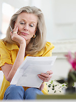 Woman reading paper documents indoors