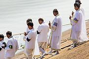 "05 FEBRUARY 2013 - PHNOM PENH, CAMBODIA:  Brahmin priests from the Royal Court board the barge that will carry King-Father Norodom Sihanouk's ashes up the Mekong River. Sihanouk's ashes will be scattered in locations across Cambodia. Tuesday, they were scattered on the Mekong River. Norodom Sihanouk (31 October 1922 - 15 October 2012) was the King of Cambodia from 1941 to 1955 and again from 1993 to 2004. He was the effective ruler of Cambodia from 1953 to 1970. After his second abdication in 2004, he was given the honorific of ""The King-Father of Cambodia."" Sihanouk died in Beijing, China, where he was receiving medical care, on Oct. 15, 2012.   PHOTO BY JACK KURTZ"