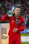 Portugal forward Cristiano Ronaldo (7) receives the trophy after winning the UEFA Nations League match between Portugal and Netherlands at Estadio do Dragao, Porto, Portugal on 9 June 2019.