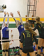 Washington's Kirsten Peterson (19) and Danielle Franklin (10) try to block a shot by Hempstead's Haley Van Cleave (10) during the MVC Volleyball Tournament Championship game between the Hempstead Mustangs and the Washington Warriors at Kennedy High School in Cedar Rapids on Saturday October 13, 2012. Hempstead defeated Washington 25-21 25-19.