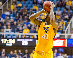 Dec 21, 2015; Morgantown, WV, USA; West Virginia Mountaineers forward Devin Williams (41) shoots during the second half against the Eastern Kentucky Colonels at the WVU Coliseum. Mandatory Credit: Ben Queen-USA TODAY Sports