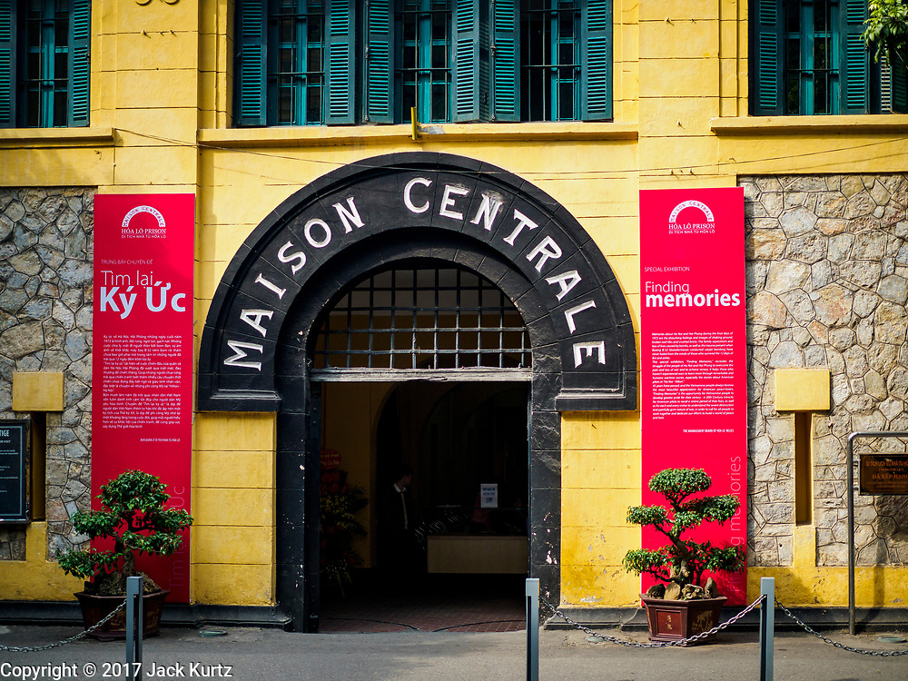 """26 DECEMBER 2017 - HANOI, VIETNAM: Hoa Lo Prison in Hanoi was used by French colonial authorities to imprison Vietnamese political prisoners and later, during the """"American War"""" by the North Vietnamese, to house American Prisoners of War, including John McCain and Pete Peterson. Then it earned the nickname the """"Hanoi Hilton."""" Peterson became the first American ambassador to Vietnam after relations were normalized.       PHOTO BY JACK KURTZ"""
