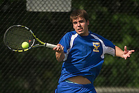 Gilford's Andrew Caulfield makes a return on Bow's David Anderson-Nelson during their singles match Tuesday afternoon.  (Karen Bobotas/for the Laconia Daily Sun)