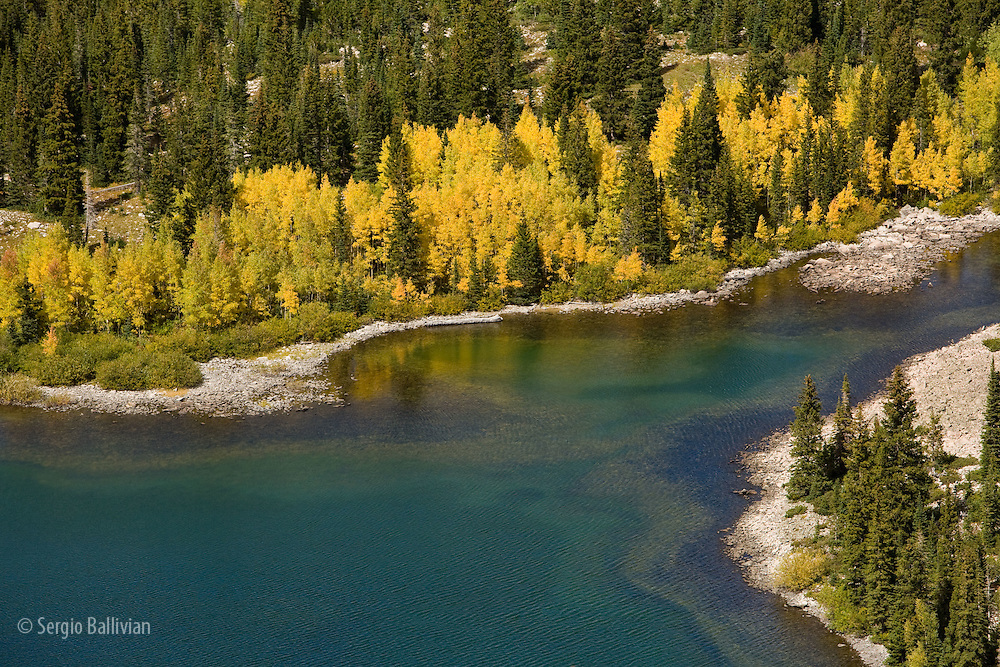 The beauty of fall colors on the slopes and lakes at the foot of Mt. Sopris near Carbondale, Colorado.