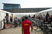 A cyclist from the Chinese National Team arrives in the team mechanic area of the 2011 Tour of Beijing.
