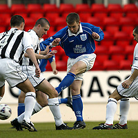 St Johnstone v Dunfermline   12.01.02<br />Craig Russell gets a shot in on goal despite the close attention of Pars defenders<br /><br />Pic by Graeme Hart<br />Copyright Perthshire Picture Agency<br />Tel: 01738 623350 / 07990 594431