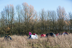 Harefield, UK. 19 January, 2020. A camp pitched by activists from Extinction Rebellion, Stop HS2 and Save the Colne Valley attending a 'Stand for the Trees' event timed to coincide with tree felling work for the high-speed rail link on land from which bailiffs acting for HS2 had evicted activists living in the Colne Valley wildlife protection camp almost two weeks previously. The trees behind the campsite are expected to be destroyed imminently for HS2, as well as 108 ancient woodlands.