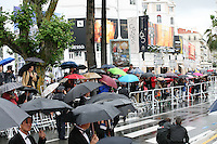 The rain continues as guests arrive at the  DA-REUN NA-RA-E-SUH (IN ANOTHER COUNTRY)  gala screening at the 65th Cannes Film Festival France. Monday 21st May 2012 in Cannes Film Festival, France.