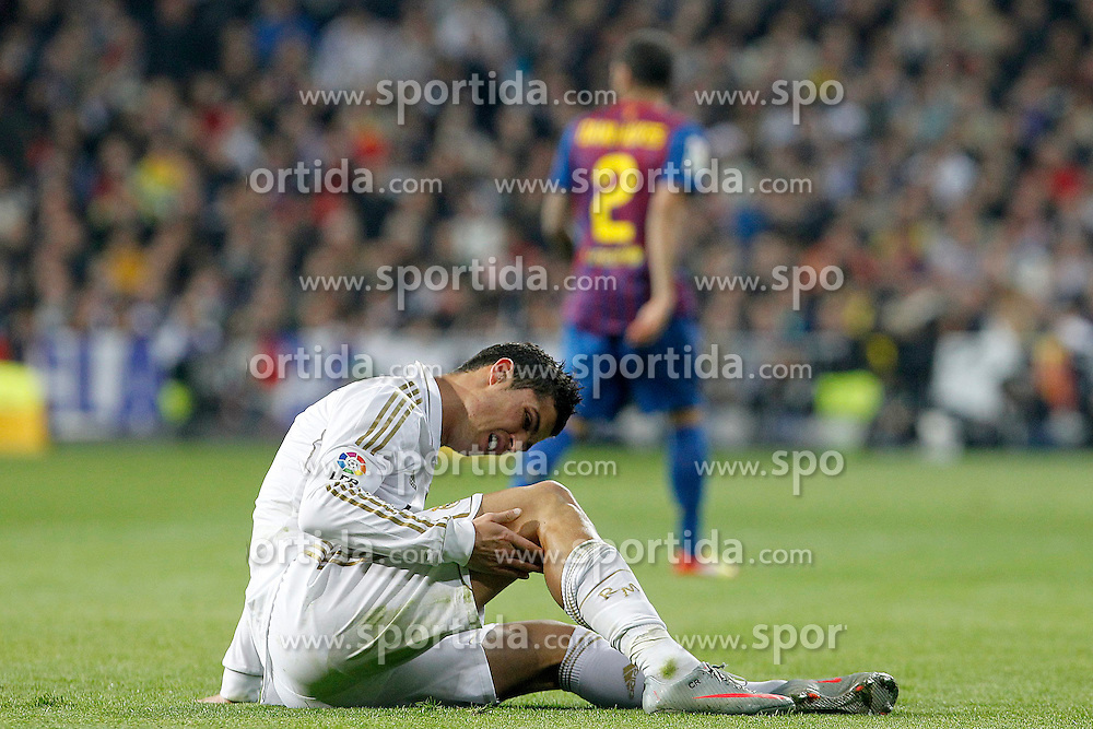 18.01.2012, Santiago Bernabeu Stadion, Madrid, ESP, Copa del Rey, Real Madrid vs FC Barcelona, im Bild Real Madrid's Cristiano Ronaldo injured // during Spanish King's Cup match.January 18,2011, 2012. EXPA Pictures © 2012, PhotoCredit: EXPA/ Alterphotos/  Acero..***** ATTENTION - OUT OF ESP and SUI *****