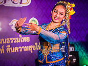 "24 JULY 2014 - BANGKOK, THAILAND: A traditional dancer performs at the happiness party in Bangkok. The Thai Junta is organizing a series of public events throughout Thailand meant to bolster public opinion. The events are called ""restoring happiness to the people"" parties. They feature historic pageants, music, food, health checks and free haircuts. The party in Bangkok is on Sanam Luang, the Royal Parade Ground, which is near the Grand Palace and the Ministry of Defense.    PHOTO BY JACK KURTZ"