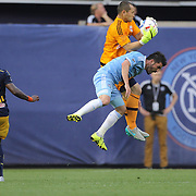 Goalkeeper Luis Robles, New York Red Bulls, catches the ball while challenged by David Villa, NYCFC, during the New York City FC Vs New York Red Bulls, MSL regular season football match at Yankee Stadium, The Bronx, New York,  USA. 28th June 2015. Photo Tim Clayton