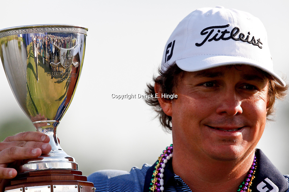 Apr 29, 2012; Avondale, LA, USA; Jason Dufner holds the championship trophy after defeating Ernie Els in a two hole playoff in the final round of the Zurich Classic of New Orleans at TPC Louisiana. Mandatory Credit: Derick E. Hingle-US PRESSWIRE
