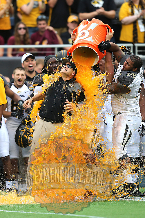 ORLANDO, FL - JANUARY 01:  Head coach Gary Pinkel of the Missouri Tigers gets Gatorade dumped on him after winning the Buffalo Wild Wings Citrus Bowl between the Minnesota Golden Gophers and the Missouri Tigers at the Florida Citrus Bowl on January 1, 2015 in Orlando, Florida. (Photo by Alex Menendez/Getty Images) *** Local Caption *** Gary Pinkel