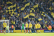 Watford players celebrate after Watford go top of the league in the Sky Bet Championship match between Watford and Middlesbrough at Vicarage Road, Watford, England on 6 April 2015. Photo by David Charbit.