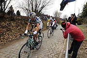 Belgium, March 31 2013: On the second pass over the Oude-Kwaremont, a small group of riders led the race. This group included Mirko Selvaggi, VACANSOLEIL-DCM, and Andre Greipel, LOTTO-BELISOL, during the elite men's edition of the Ronde van Vlaandaren 2013 cycle race. Copyright 2013 Peter Horrell.