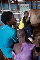 Phiona Mutesi, left, a 14-year-old chess prodigy, at the Agape Church inside Katwe, the largest slum in Kampala, Uganda, Dec. 8, 2010. Mutesi lives in the slums of Uganda and is just now learning to read. But her instincts have made her a player to watch in international chess. Mutesi, a naturally talented chess player is coached by Robert Katende of Sports Outreach Ministry. The chess club meets at the Agape Church.