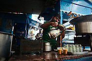 Preparing chai on a stand at Udaipur's old town