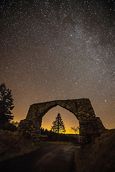 © London News Pictures. 24/01/2017. Devil's Bridge Ceredigion, UK.  On a cold clear night in Mid Wales, the stars of the Milky Way is a clear band in the deep dark night sky over the 'Hafod Arch' , a 19th century folly in the hills above Devil's Bridge in the Cambrian Mountains, inland from Aberystwyth, Ceredigion. Photo credit: Keith Morris/LNP