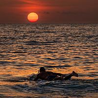 A super paddles toward the sun near off the shore of Captiva Island.