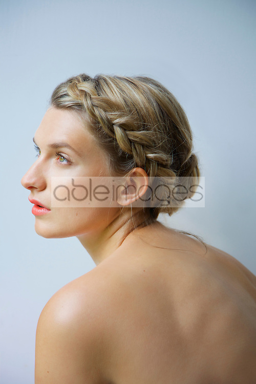 Profile of Young Woman with Braided Hair