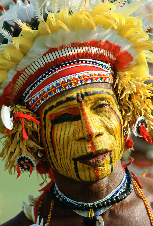 Native man with face paint at a Sing Sing tribal gathering, Papua New Guinea