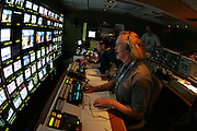GLENDALE, AZ - JANUARY 8:  Mike Burks and Rich Russo (producer and director) work in the television production truck at FOX Sports telecast of the Ohio State Buckeyes game against the Florida Gators at the 2007 Tostitos BCS National Championship Game at the University of Phoenix Stadium on January 8, 2007 in Glendale, Arizona. The Gators defeated the Buckeyes 41-14. ©Paul Anthony Spinelli *** Local Caption *** Mike Burks;Rich Russo