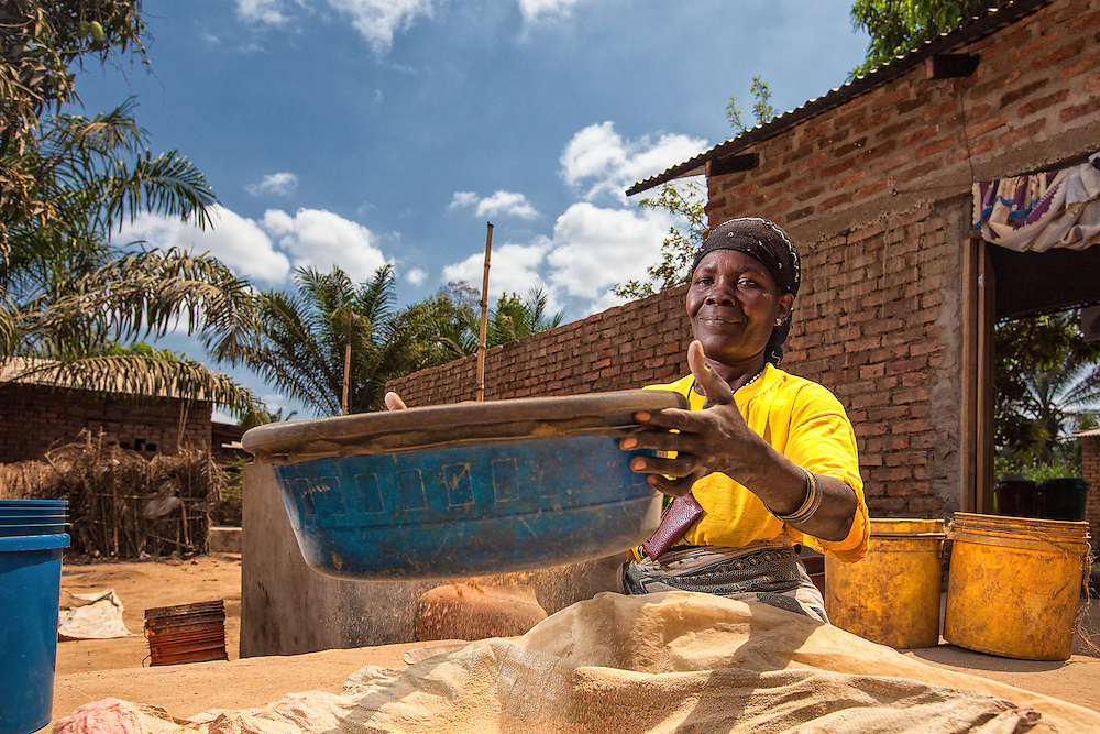 A Tanzanian woman sifts clay for use in filtration buckets. The pottery team at MSABI works to create and distribute filtration pots to villages and schools to prevent waterborne illness.
