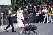 President and First Lady Nancy Reagan leave the white House for Camp David in June 1985.  First dog, Lucky is leading the way...Photo by Dennis Brack BSB 18