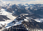 Aerial view of Denali (Mt. McKinley; out of view on the upper left), the Kahiltna Glacier (left), the Tokositna Glacier (right) and the Alaska Range on a sightseeing flight from Talkeetna, Alaska.