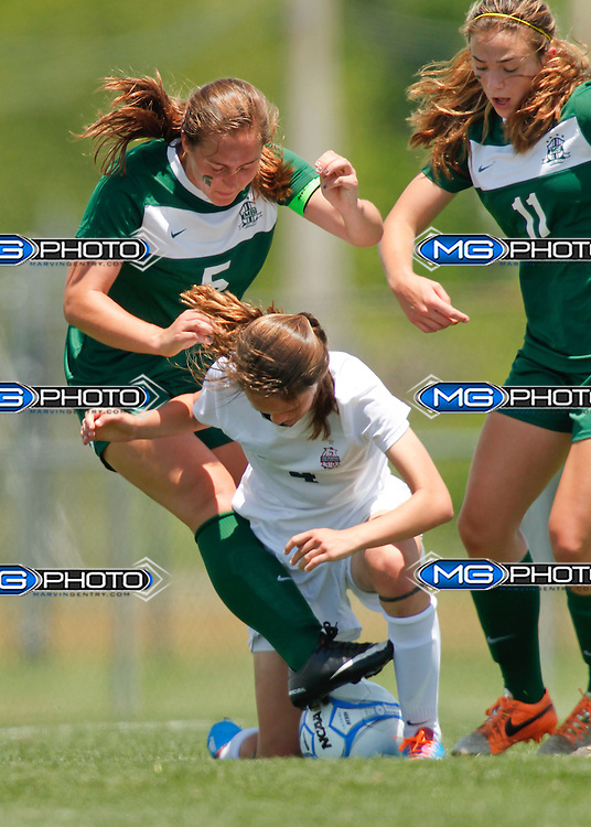 May 10, 2014; Huntsville, AL, USA;  Oak Mountain Julia Marie Pack (4) tries to keep the ball from Mountain Brook Elizabeth Clutton (5) during the 6A State Girls Soccer Championship at John Hunt Soccer Complex. Mandatory Credit: Marvin Gentry