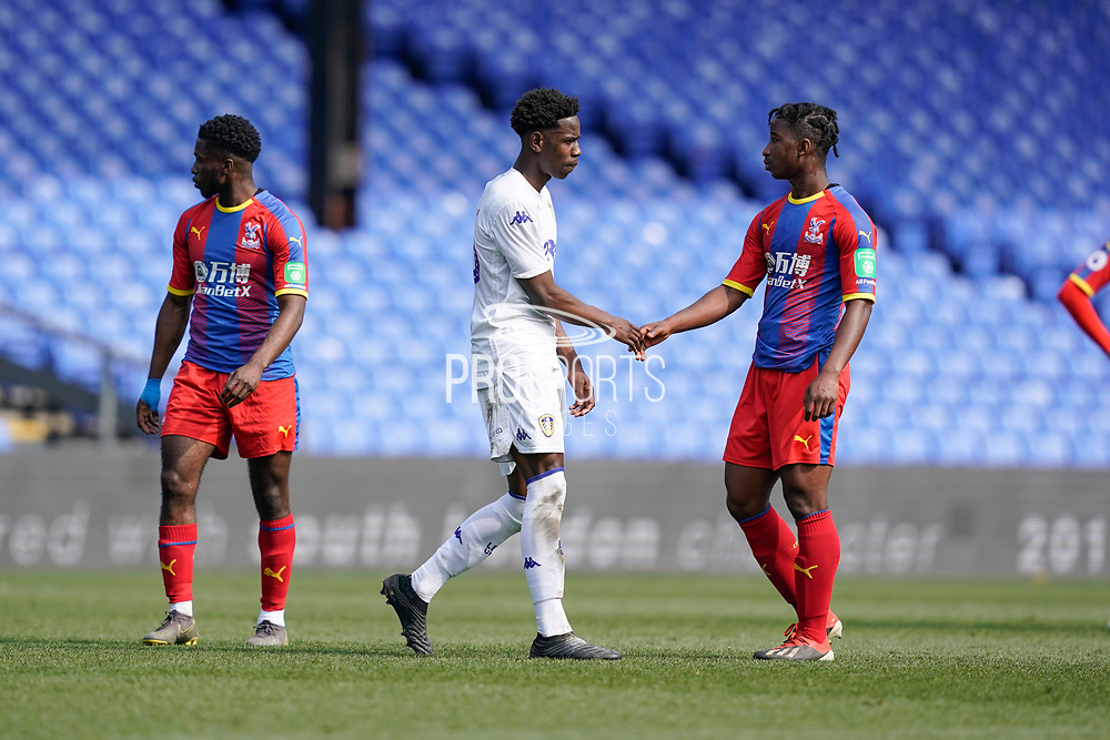Players shake hands as the game ends 2-2 during the U23 Professional Development League match between U23 Crystal Palace and Leeds United at Selhurst Park, London, England on 15 April 2019.