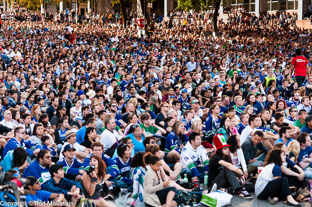Vancouver, BC, Canada - June 6, 2011 - A crowd gathered along Georgia Street near the CBC studio to enjoy a hockey playoff game.<br />
