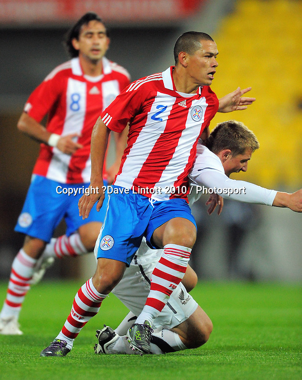 Chris Wood goes down under a challenge from Paraguay's Dario Veron. International football friendly - New Zealand All Whites v Paraguay at Westpac Stadium, Wellington on Tuesday, 12 October 2010. Photo: Dave Lintott / photosport.co.nz