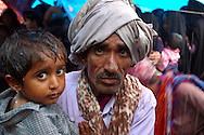 Father and son getting drenched at a Maldhari wedding..Michael Benanav - mbenanav@gmail.com