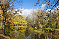 Trees show their autumn colors along a  pond in Sigulda, Latvia