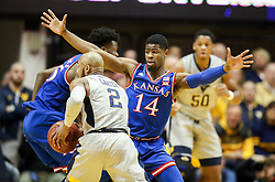 Jan 15, 2018; Morgantown, WV, USA; Kansas Jayhawks guard Malik Newman (14) defends West Virginia Mountaineers guard Jevon Carter (2) during the first half at WVU Coliseum. Mandatory Credit: Ben Queen-USA TODAY Sports