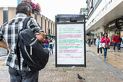 London, UK. 30 July, 2019. A passerby reads one of several adhacks attacking Boris Johnson with an adaptation of New York-based artist Zoe Leonard's blistering 'I Want A President' which have appeared around the newly-appointed Prime Minister's constituency of Uxbridge and South Ruislip. They were produced by the artist Protest Stencil in tribute to Zoe Leonard to coincide with the #FckBoris events.