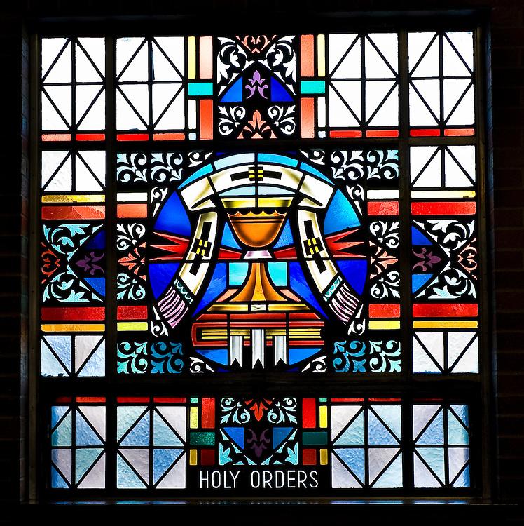 Stained glass image illustrating Sacrament of Holy Orders at St. Mary Church in Peshtigo, Wis. (Sam Lucero photo)