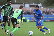 AFC Wimbledon striker Andy Barcham (17) taking on Plymouth Argyle defender Gary Sawyer (3) during the EFL Sky Bet League 1 match between AFC Wimbledon and Plymouth Argyle at the Cherry Red Records Stadium, Kingston, England on 21 October 2017. Photo by Matthew Redman.
