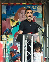 Scottish Lawyer Anas Anwar speaks at the Protest in Glasgow against Donald Trump. Demonstrators attend rally in George Square, Glasgow in protest against the visit to Scotland of American President Donald Trump. Angie Isac | EEm, Friday 13 July 2018