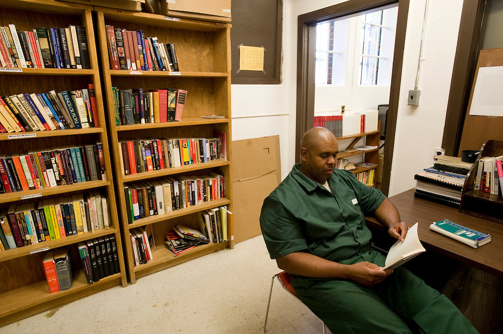 """Inmate and Bard College student Stacey C. Williams studies in the library at Woodbourne Correctional Facility. Stacey has been sentenced to 10 years of which he has spent 6. He graduated from Bard with  Bachelor of Art (BA) in June 2010...Story: The Bard Prison Initiative.Former inmate Carlos Rosario, 35-year-old husband and father of four, was released from Woodbourne Correctional Facility after serving more than 12 years for armed robbery. Rosado is one of the students participating in the Bard Prison Initiative, a privately-funded program that offers inmates at five New York State prisons the opportunity to work toward a college degree from Bard College. The program, which is the brainchild of alumnus Max Kenner, is competitive, accepting only 15 new students at each facility every other year. .Carlos Rosario received the Bachelor of Arts degree in social studies from the prestigious College Saturday, just a few days after his release. He had been working on it for the last six years. His senior thesis was titled """"The Diet of Punishment: Prison Food and Penal Practice in the Post-Rehabilitative Era,"""".Rosado is credited with developing a garden in one of the few green spaces inside the otherwise cement-heavy prison. In the two years since the garden's foundation, it has provided some of the only access the prison's 800 inmates have to fresh vegetables and fruit...Rosario now works for a recycling company in Poughkeepsie, N.Y...Photo © Stefan Falke"""