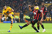 Wolverhampton Wanderers forward Raul Jimenez (9)shoots past Nathan Ake (5) of AFC Bournemouth during the Premier League match between Wolverhampton Wanderers and Bournemouth at Molineux, Wolverhampton, England on 15 December 2018.