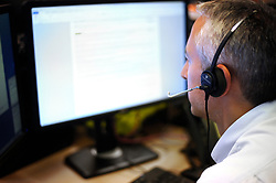 PICTURE POSED BY MODEL A generic stock photo of an office worker using a hands free headset .