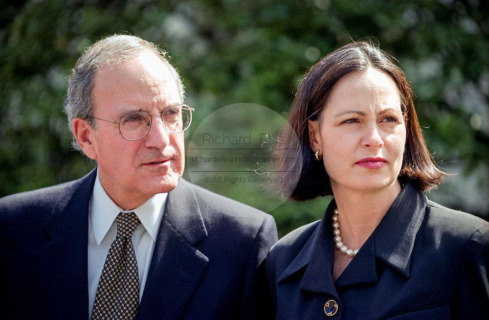 Former senator and Special Envoy for Northern Ireland Peace Envoy George Mitchell with wife Heather MacLachlan speak to the media at the White House April 13, 1998 in Washington, DC. Mitchell, who chaired the peace talks in Northern Ireland, praised Clinton for his help in negotiating the agreement reached April 10th in Belfast.