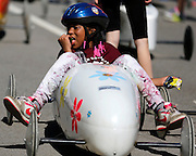 Seven Williams, 8, of Rochester, rests in her car at a local soapbox derby race on Lakeshore Boulevard in Irondequoit on Saturday, May 31, 2014. Eighty-two competitors raced in six divisions, with the winner of each division advancing to the world championships in Akron, Ohio.