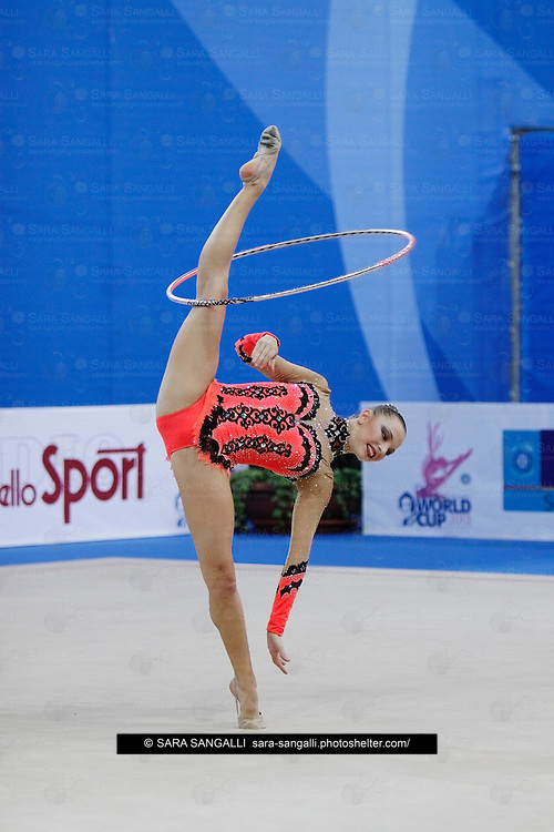 PESARO, ITALY - APRIL 28: Melitina Staniouta from Belarus performs with hoop during the rhythmic gymnastic World Cup on April 28, 2013 in Pesaro, Italy