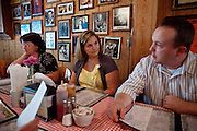 Curtis Hice, 27, is having lunch with his wife (centre) and mother in-law (left) in Winchester, Tennessee, where he works at Social Security office. He lives with his wife and 2-year-old daughter. Curtis was a Marine combat engineer and fought during the first battle for Fallujah. After returning to the USA, he became more devoted and turned into religion. He is now the solo singer at his community church..